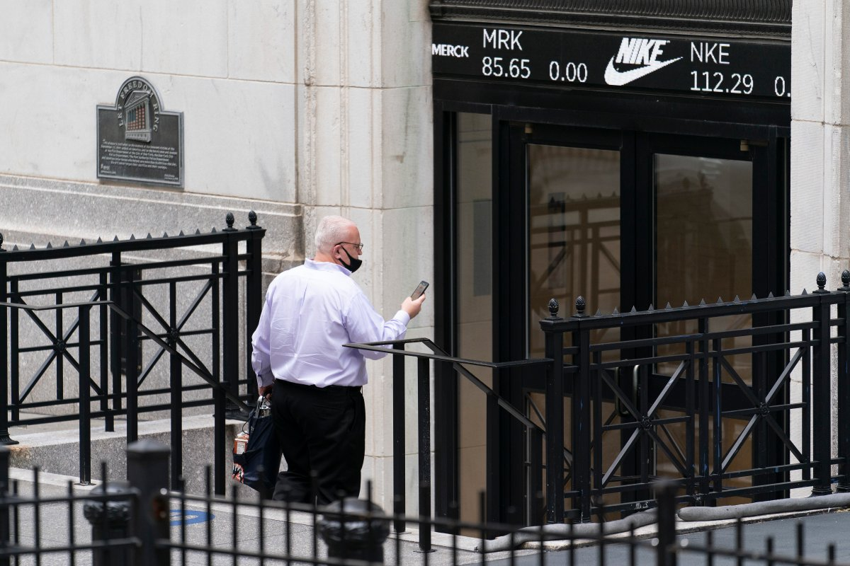 A man enters the New York Stock Exchange, Monday, Aug. 31, 2020, in New York.