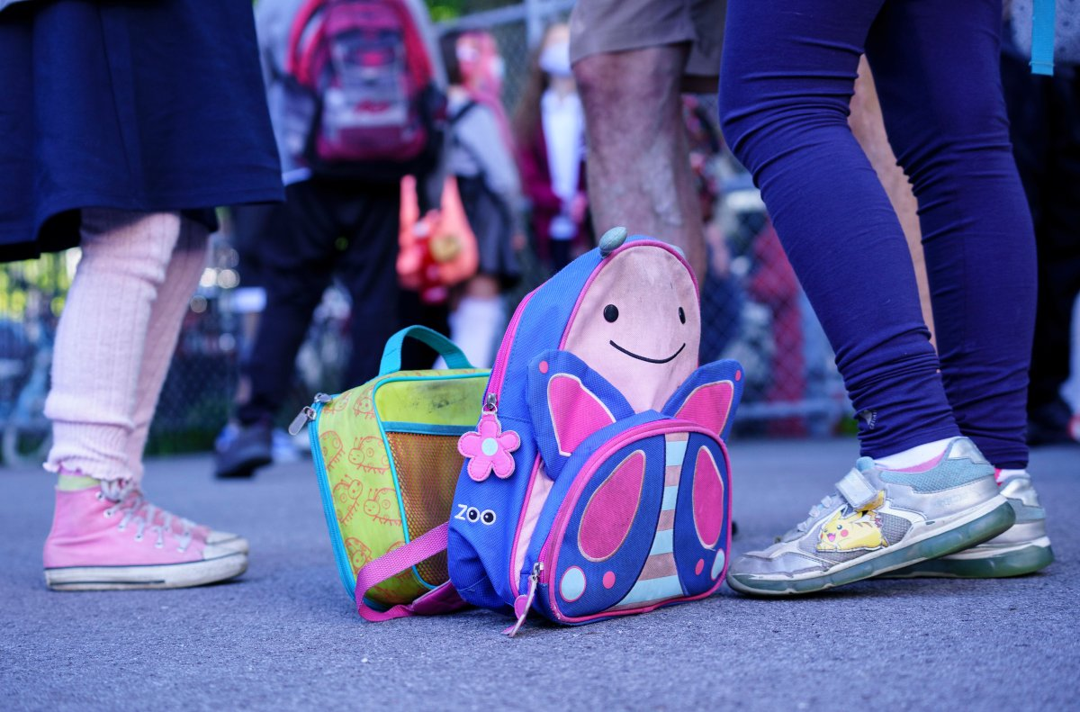 A school bag and a lunch bag are seen in the school yard at the Bancroft Elementary School as students go back to school in Montreal, on Monday, August 31, 2020.
