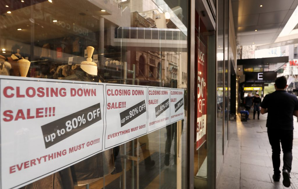 Signs in store window advertise that they are closing in Sydney, Wednesday, Sept. 2, 2020. Australia's economy has suffered its sharpest quarterly drop since the Great Depression because of the pandemic, with data released on Wednesday confirming the country is experiencing its first recession in 28 years.