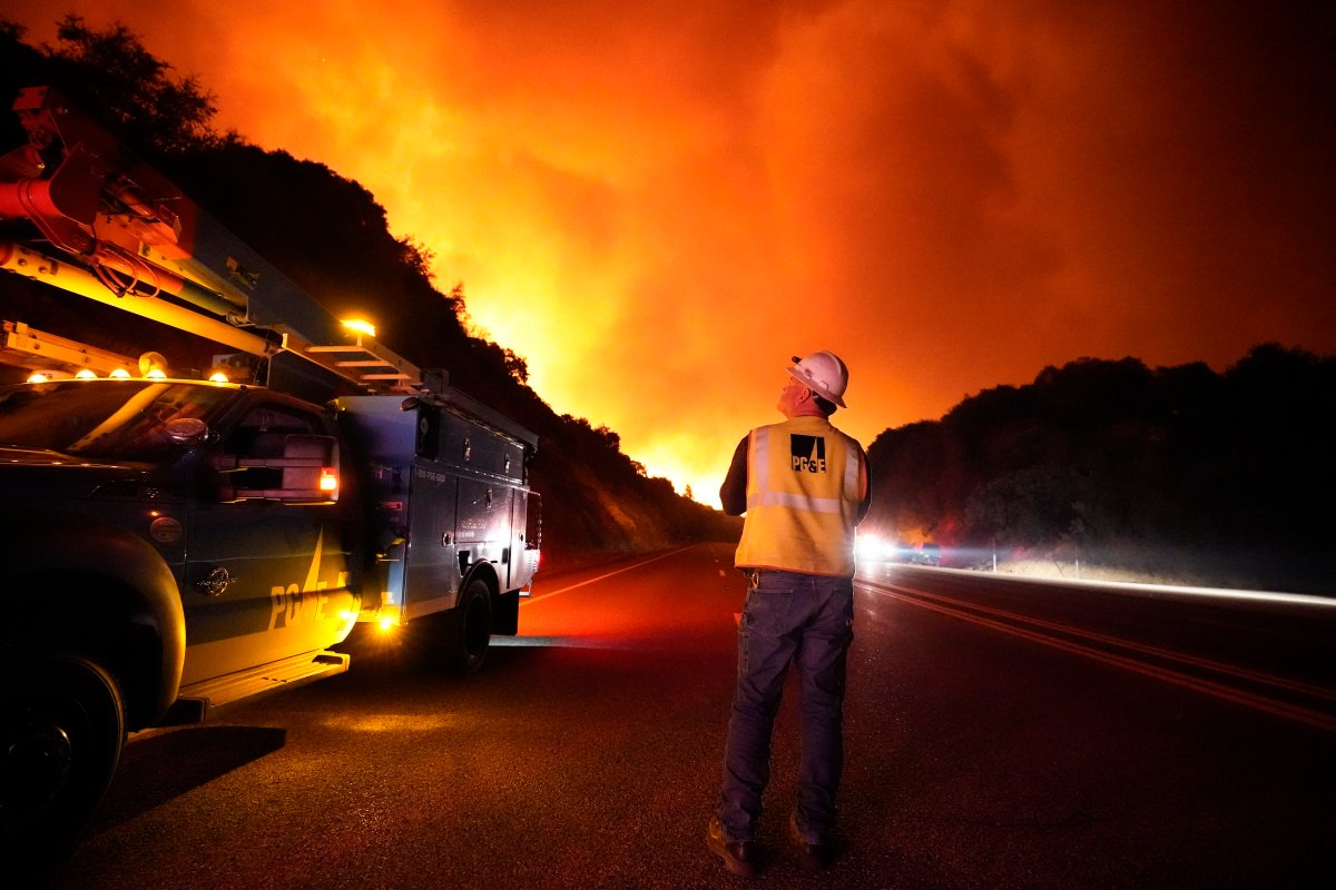 A Pacific Gas and Electric worker looks up at the advancing Creek Fire along Highway 168 Tuesday, Sept. 8, 2020, near Alder Springs, Calif. Smoke from the fires aren't expected to cause problems in Manitoba.
