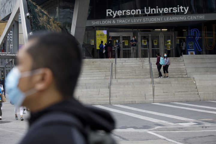 People are seen on the front steps of Ryerson University on campus in Toronto, Tuesday, Sept. 8, 2020.
