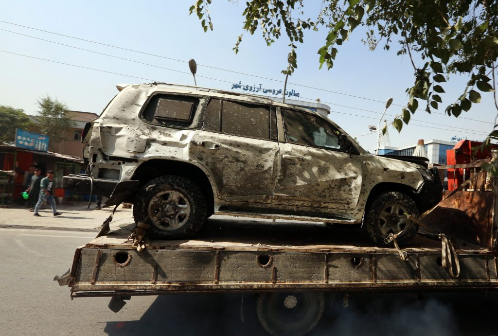 The vehicle that Afghanistan's Vice President Amrullah Saleh was traveling in sits on a truck after an explosion targeted his motorcade in Kabul, Afghanistan.