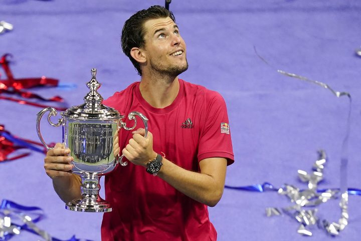 Dominic Thiem, of Austria, holds up the championship trophy after defeating Alexander Zverev, of Germany, in the men's singles final of the US Open tennis championships, Sunday, Sept. 13, 2020, in New York.
