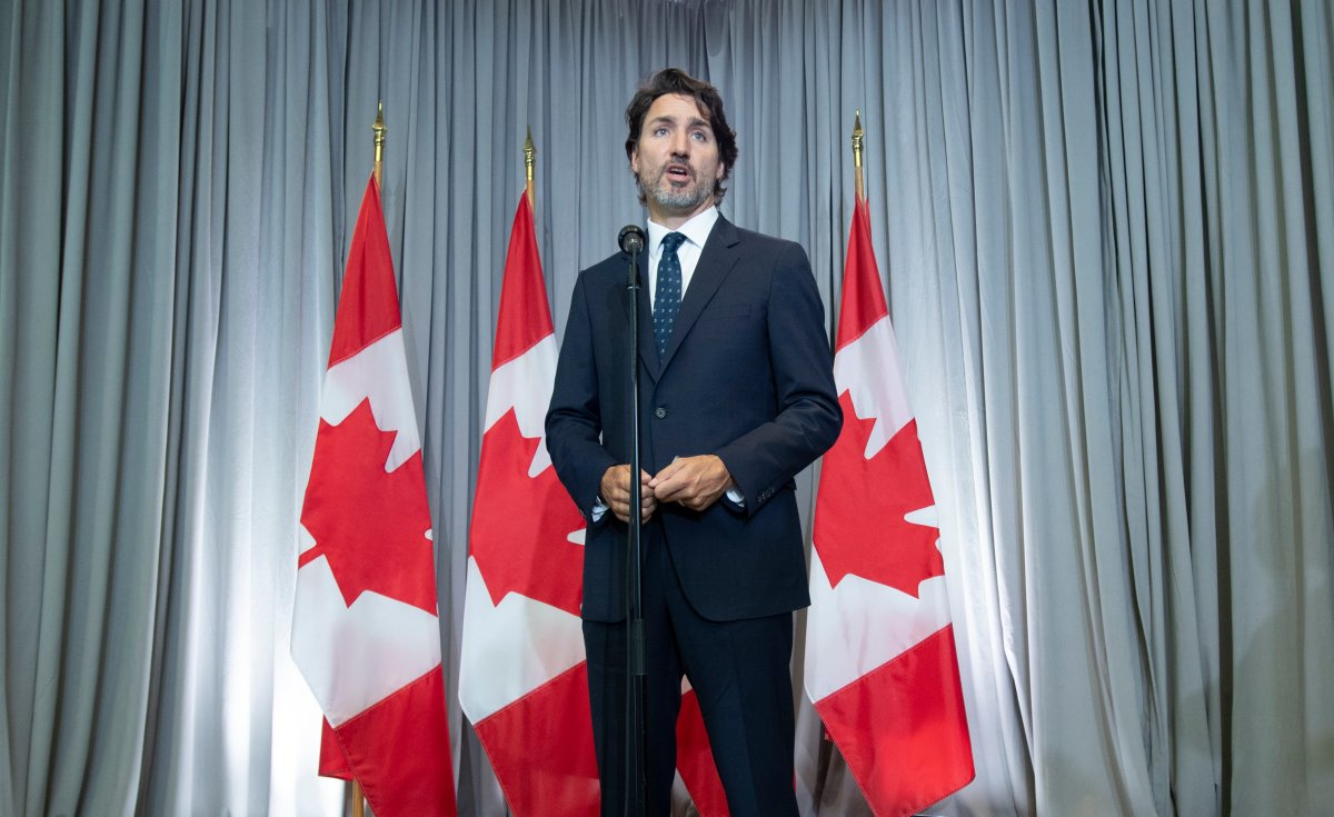 Prime Minister Justin Trudeau speaks with the media before the first day of a Liberal cabinet retreat in Ottawa, Monday, Sept. 14, 2020.