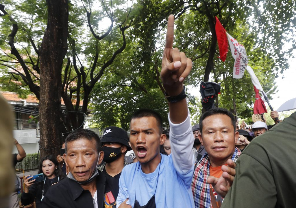 Pro-democracy protester Panupong Jadnok gestures as he enters the gate to Thammasat University during a protest in Bangkok, Thailand, Saturday, Sept. 19, 2020. Protesters gathered Saturday in Bangkok for what was expected to be the biggest rally yet in an ongoing campaign calling for a new election and democratic reforms.