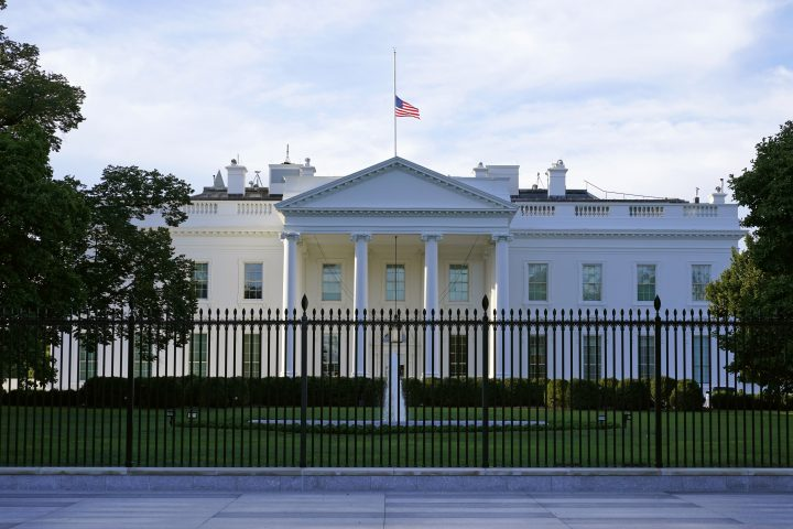 An American flag flies at half-staff over the White House in Washington, Sept. 19, 2020.