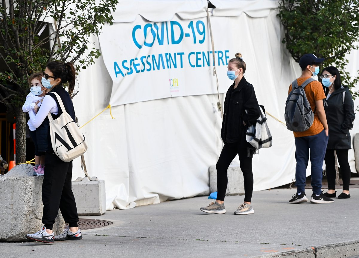 People wait in line at a COVID assessment centre at Women's College Hospital during the COVID-19 pandemic in Toronto on Wednesday, September 23, 2020. THE CANADIAN PRESS/Nathan Denette.