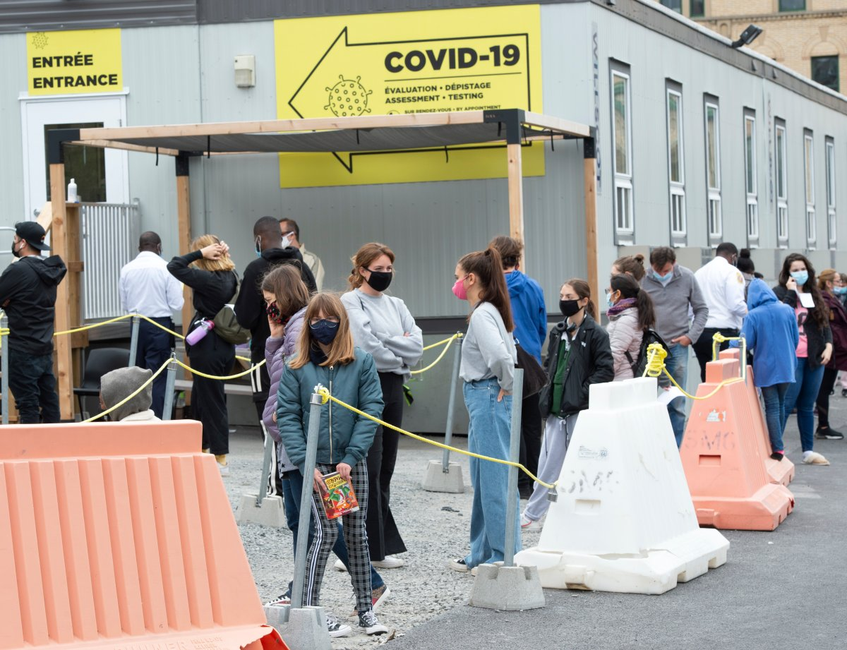 People line up at a COVID-19 testing clinic, Wednesday, Sept. 23, 2020  in Montreal.