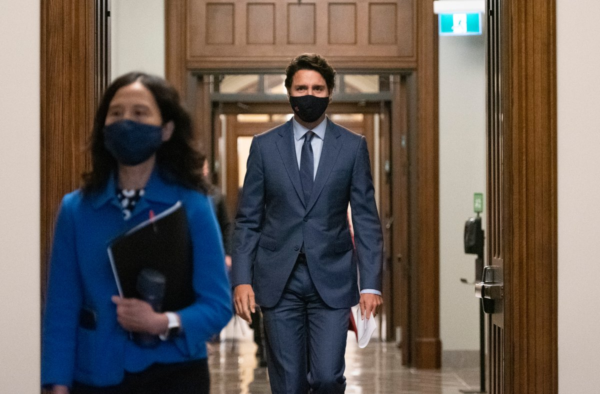 Prime Minister Justin Trudeau arrives with Chief Public Health Officer of Canada Dr. Theresa Tam, left, for a news conference on the COVID-19 pandemic on Parliament Hill in Ottawa, on Friday, Sept. 25, 2020. THE CANADIAN PRESS/Justin Tang.