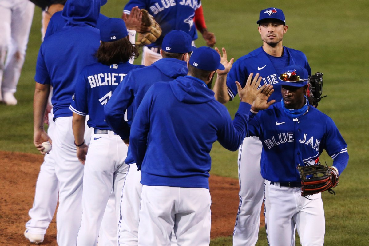 Toronto Blue Jays celebrate a 5-2 win over the Baltimore Orioles in a baseball game Saturday, Sept. 26, 2020, in Buffalo, N.Y.