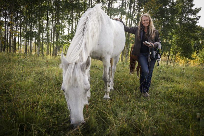 Sue McIntosh, owner of Healing Hooves equine therapy, poses with her horse Finnegan, who survived  Potomac horse fever, at her facility near Cremona, Alta., Wednesday, Sept. 23, 2020.