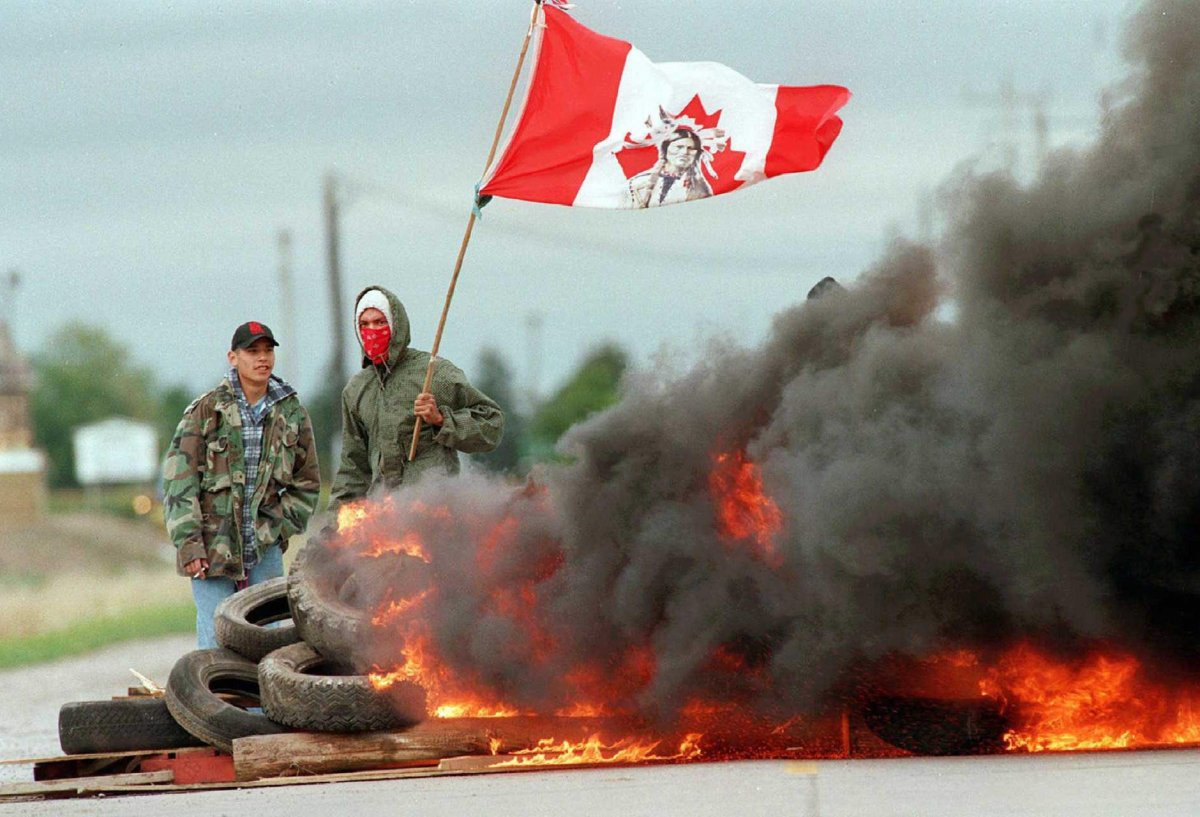 Two protesters man a barricade  near the entrance to Ipperwash Provincial Park, near Ipperwash Beach, Ont., on  Sept. 7, 1995.