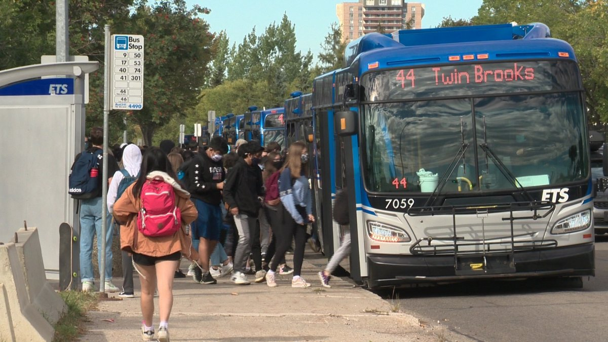 Students board ETS buses at Harry Ainlay School in Edmonton Friday, Sept. 11, 2020.