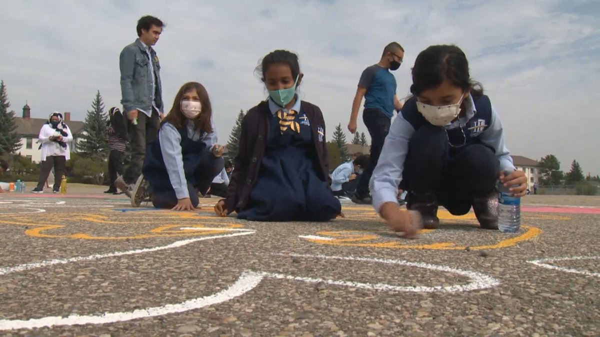 Kids and artists are brightening up the Currie neighbourhood in Calgary with chalk.