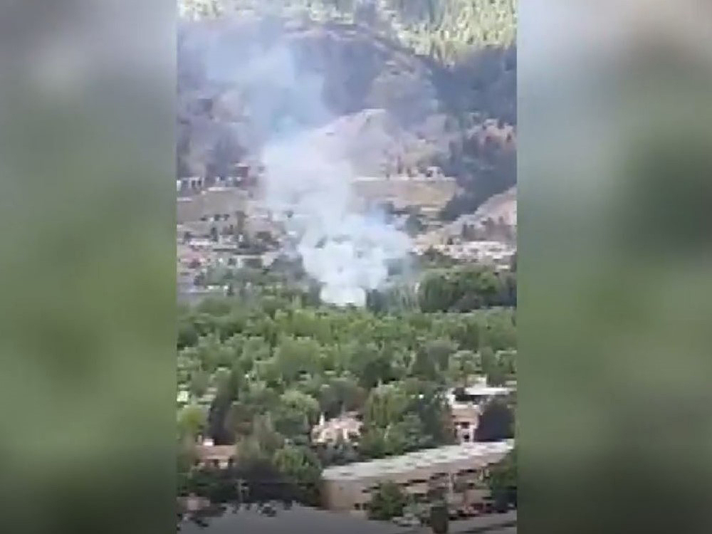 A man on a motorbike was arrested after trying to flee the fire scene on Wednesday morning, say Penticton RCMP.