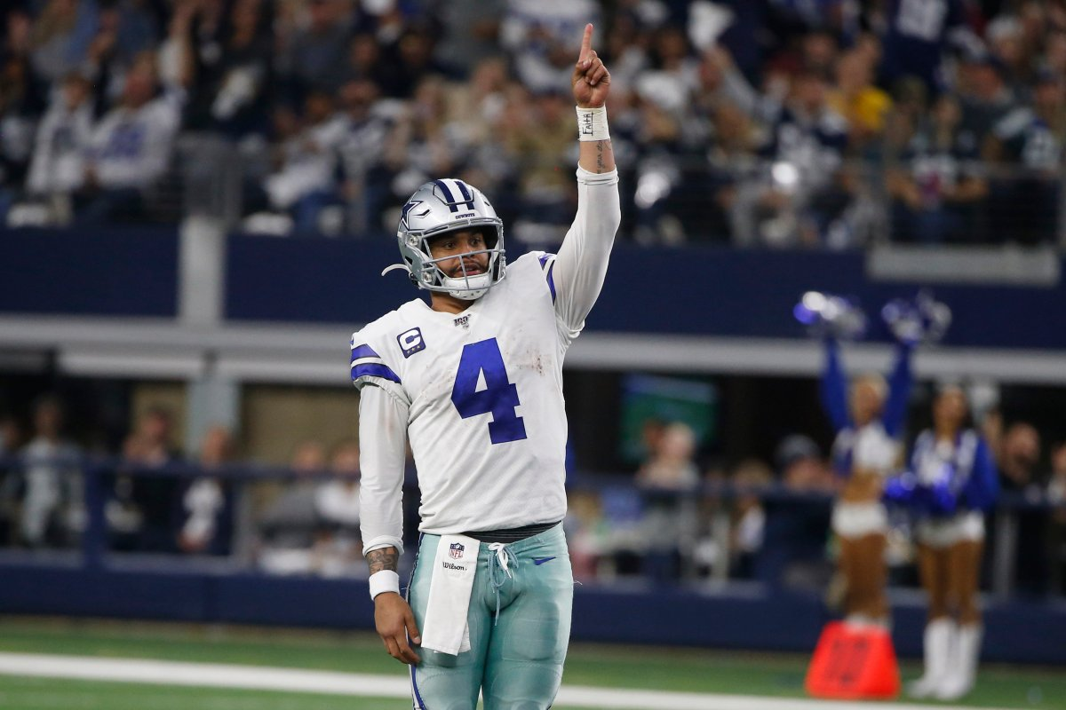 FILE-Dallas Cowboys quarterback Dak Prescott (4) celebrates a touchdown against Washington in Arlington, Texas, Sunday, Dec. 15, 2019.