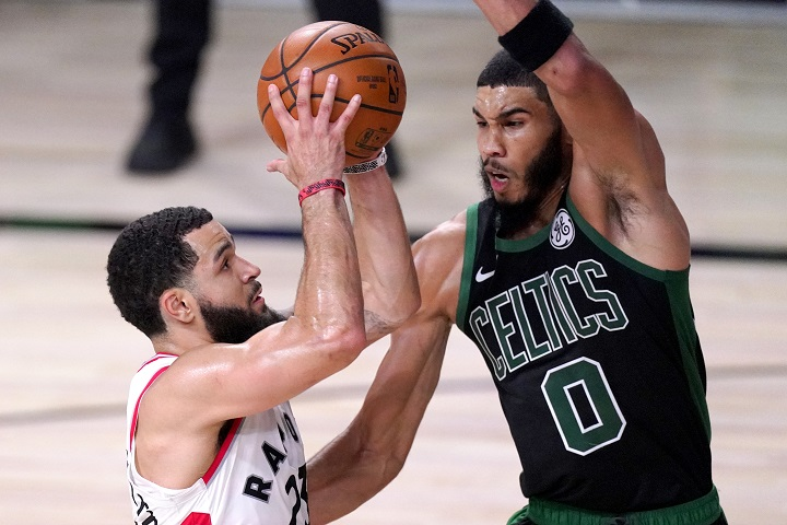 Toronto Raptors' Fred VanVleet, left, goes up for a shot against Boston Celtics' Jayson Tatum during the first half of an NBA conference semifinal playoff basketball game Friday, Sept. 11, 2020, in Lake Buena Vista, Fla. (AP Photo/Mark J. Terrill).