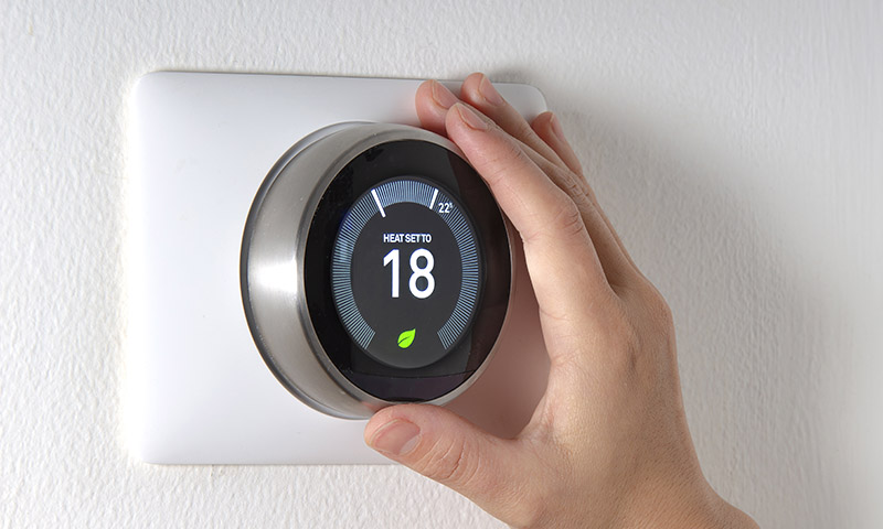 A smart thermostat being installed as part of SaskPower's new energy assistance program.