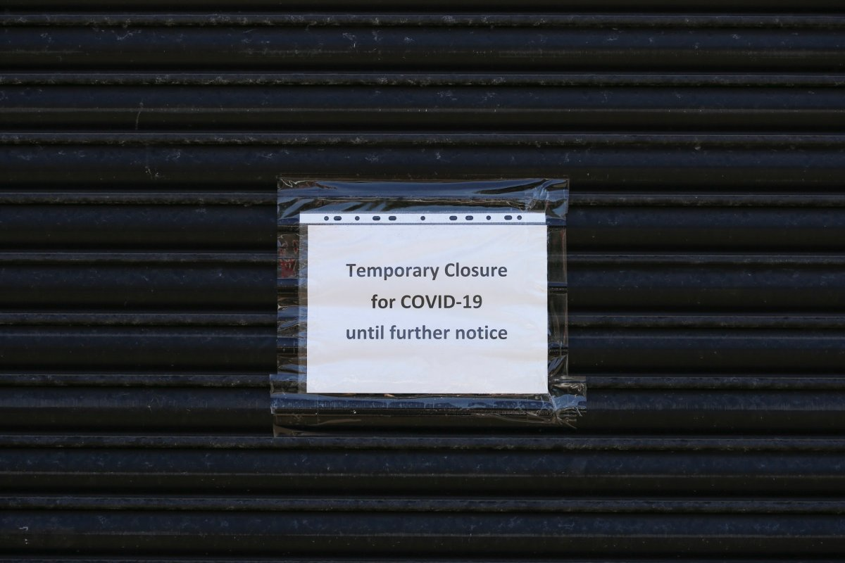 Sign on anonymous shuttered building saying 'Temporary closure for Covid 19' during the Covid 19 coronavirus pandemic.