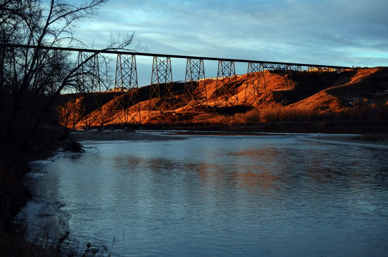 The old metal Lethbridge Viaduct passing over the Old Man River.