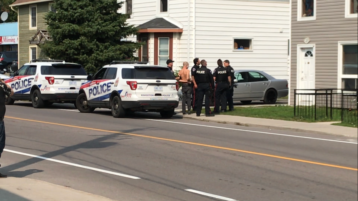 Kingston police arrested a man Tuesday afternoon after he allegedly threatened another man with a knife.