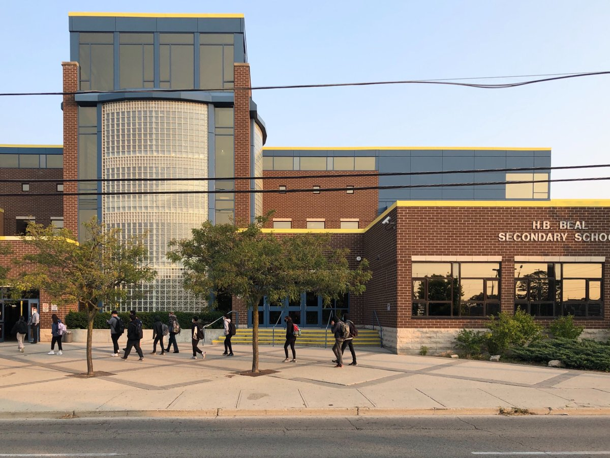 Students file into H.B. Beal Secondary School one day after a case of COVID-19 was reported at the downtown London, Ont. high school.