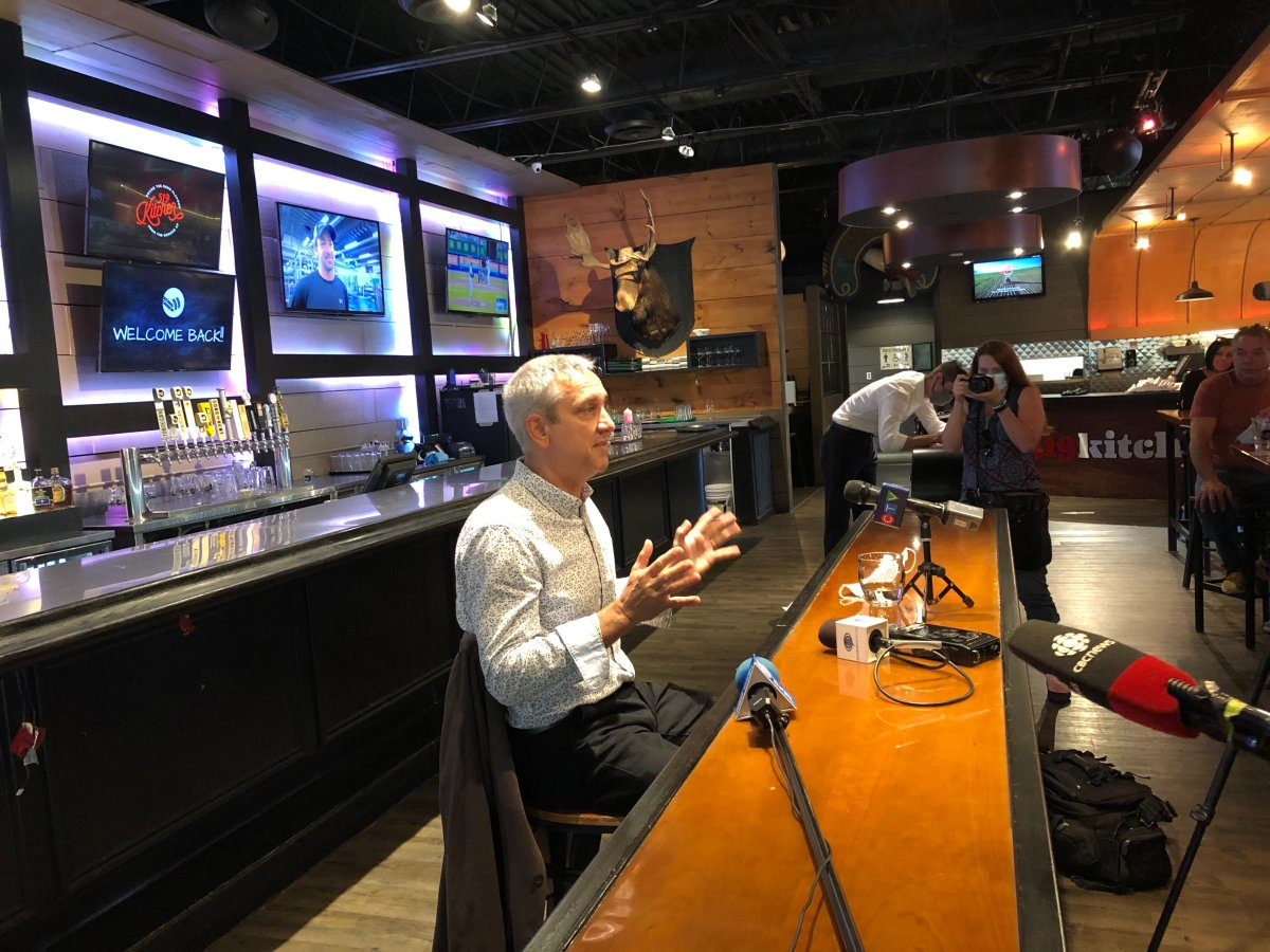 Jerry Pribil of Marienbad Restaurant addresses fellow local business owners during a news conference inside Toboggan Brewing Co. on Wednesday.