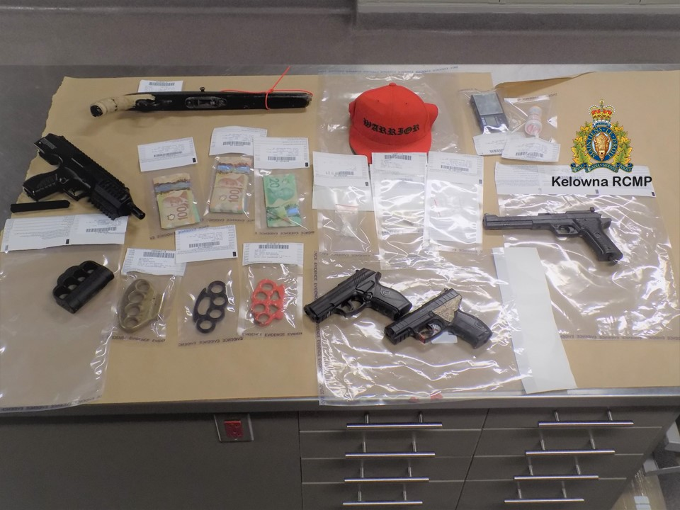 A photo of the seized items. Police say the drug bust happened Wednesday, along Lawson Avenue, with firearms, imitation firearms and illicit drugs being seized.