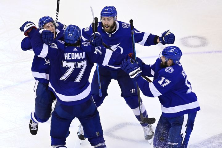 Tampa Bay Lightning defenceman Victor Hedman (77) celebrates his game-winning goal against the Boston Bruins with teammate Ondrej Palat (18), Patrick Maroon (14) and Alex Killorn (17) during the second overtime period of NHL Stanley Cup Eastern Conference playoff hockey action in Toronto on Monday, Aug. 31, 2020.