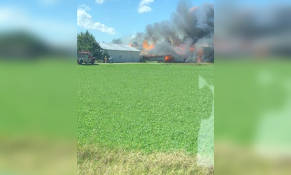 Crews are battling a barn fire in Mapleton, Ont.