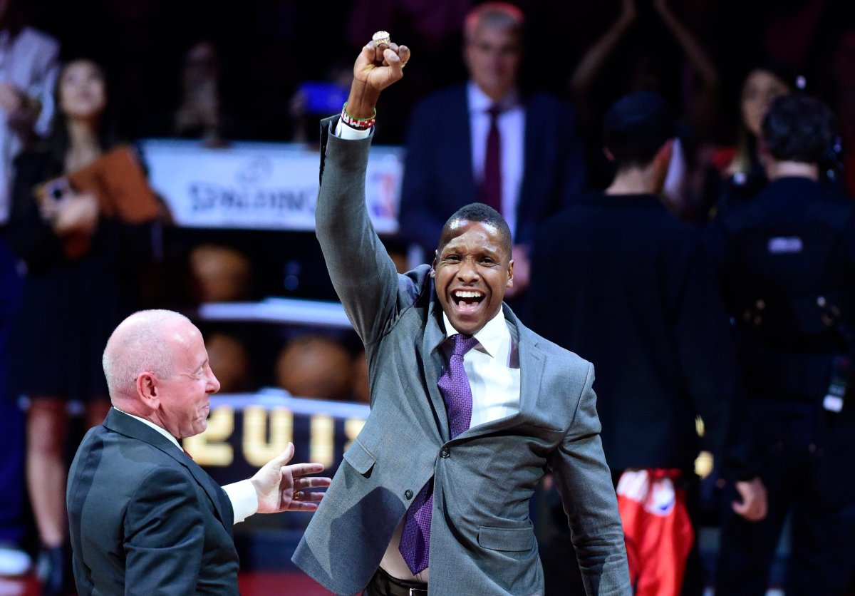 Toronto Raptors president Masai Ujiri receives his 2019 NBA championship ring from Larry Tanenbaum, chairman of Maple Leaf Sports & Entertainment, before playing the New Orleans Pelicans in Toronto on Tuesday Oct. 22, 2019.