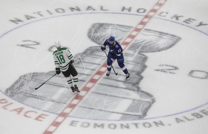 Dallas Stars' Jason Dickinson (18) and Tampa Bay Lightning's Cedric Paquette (13) warm up before the NHL Stanley Cup finals in Edmonton on Monday, September 21, 2020.