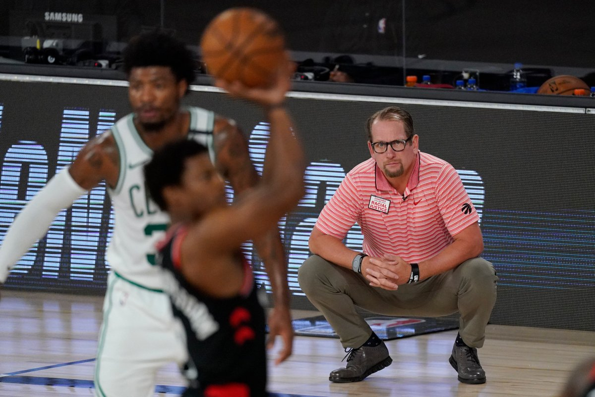 Toronto Raptors' head coach Nick Nurse, right, watches from the bench during the first half of an NBA conference semifinal playoff basketball game against the Boston Celtics Saturday, Sept. 5, 2020, in Lake Buena Vista, Fla.