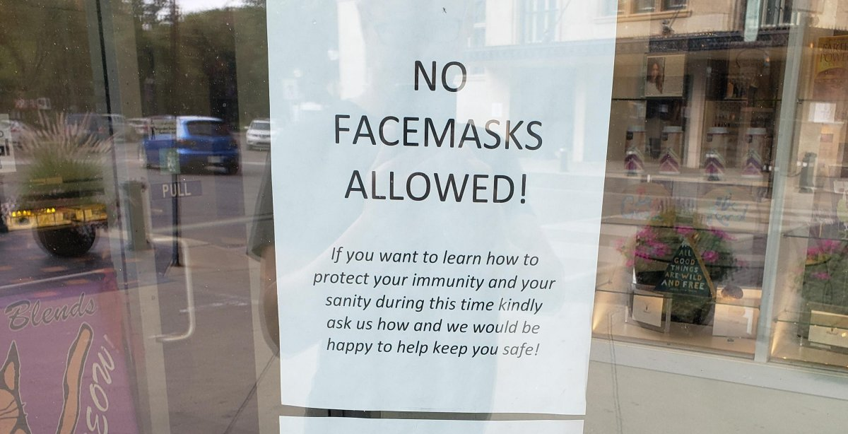 This photo shared online shows an anti-mask sign posted at a Saskatoon business downtown.