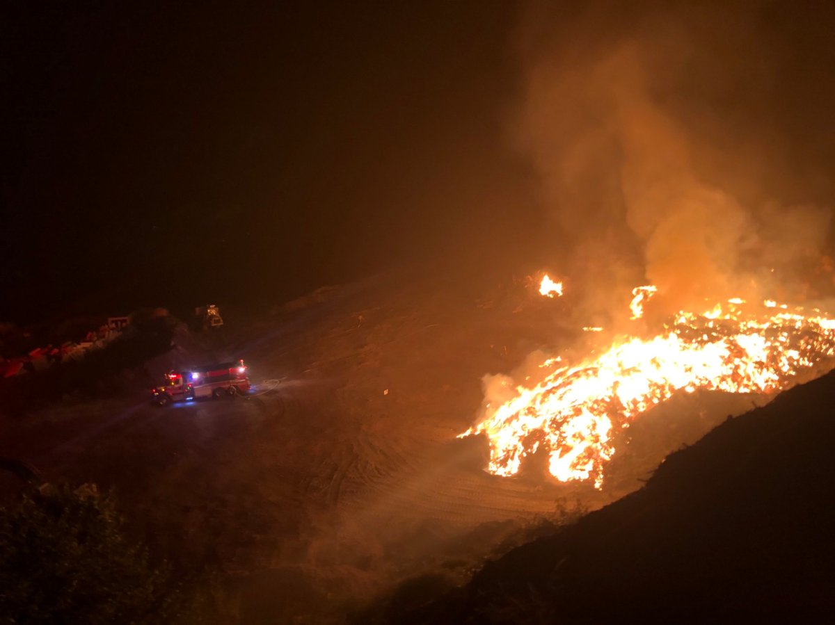 Crews spent several hours extinguishing a wood pile fire at the Campbell Mountain landfill on Sunday night.