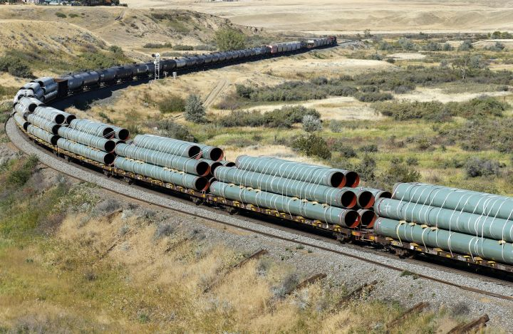 Sections of oil pipeline are transported on a westbound Canadian Pacific Railway (CPR) freight train near Medicine Hat, Alberta, Canada on Sept. 11, 2020.