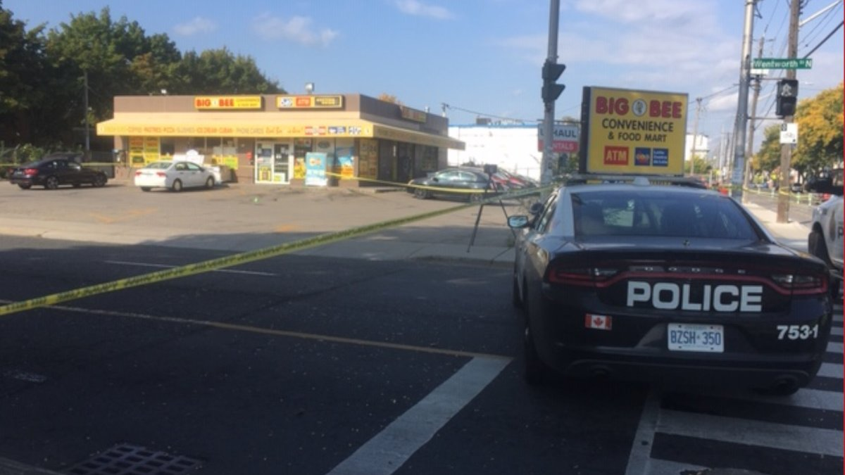 Hamilton police investigate the city's 12th homicide of 2020 near a variety store in the city's centre on Monday, Sept. 28, 2020.