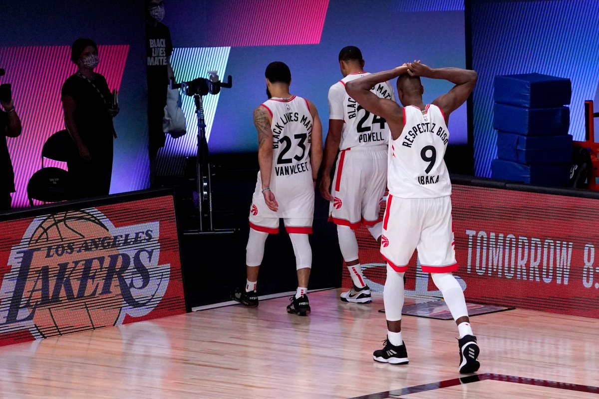 Toronto Raptors' Fred VanVleet (23), Norman Powell (24) and Serge Ibaka (9) head to the locker room after losing to the Boston Celtics in Game 7 of their NBA Eastern Conference semifinal Friday, Sept. 11, 2020, in Lake Buena Vista, Fla.