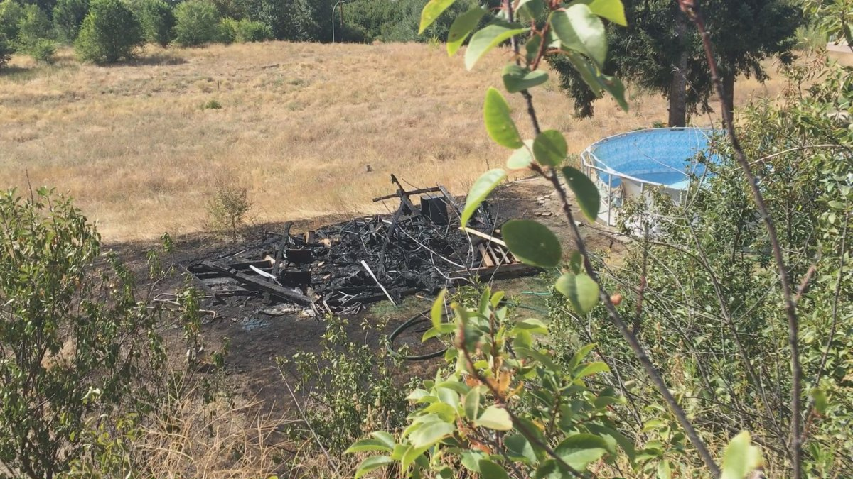 A shed fire in Kelowna spread into nearby grass on Sunday.