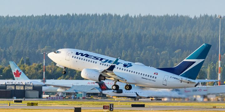 A WestJet Airlines Boeing 737-700 jet (C-FMWJ) takes off from Vancouver International Airport, Richmond, B.C. on Thursday, September 3, 2020.