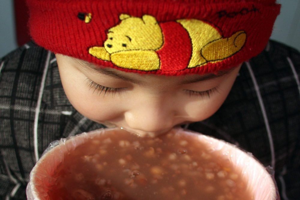 A child eats laba porridge in this Jan. 3, 2009 file photo from China.