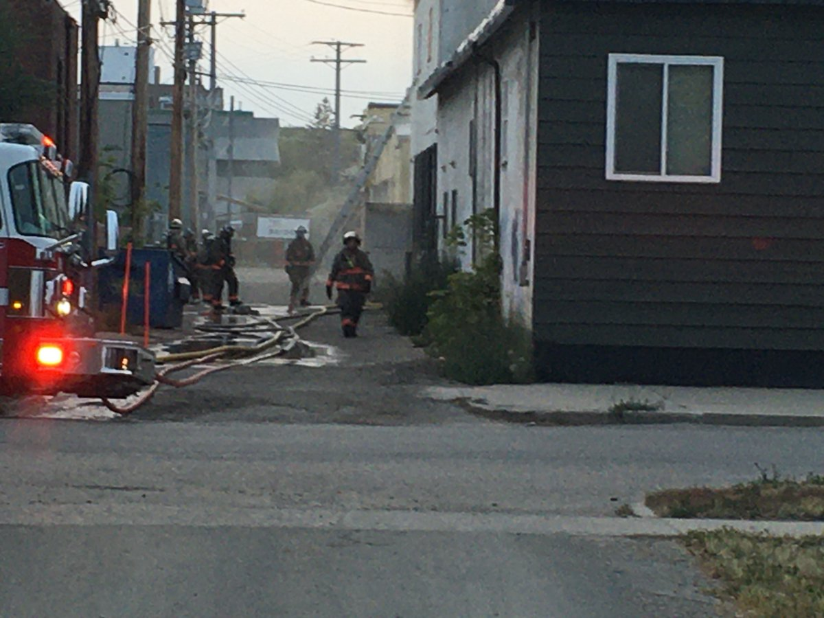 The commanding battalion chief ordered all firefighters to exit a commercial structure when the fire escalated.