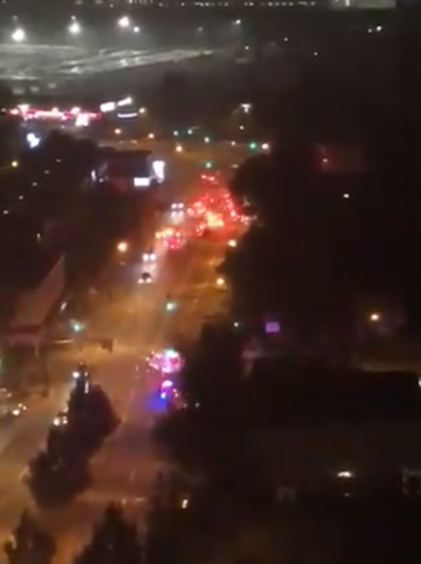 Vancouver fire crews and emergency services converge on Granville Street near West 70th Avenue to deal with a fire in a top floor suite of a residential building Thursday night.