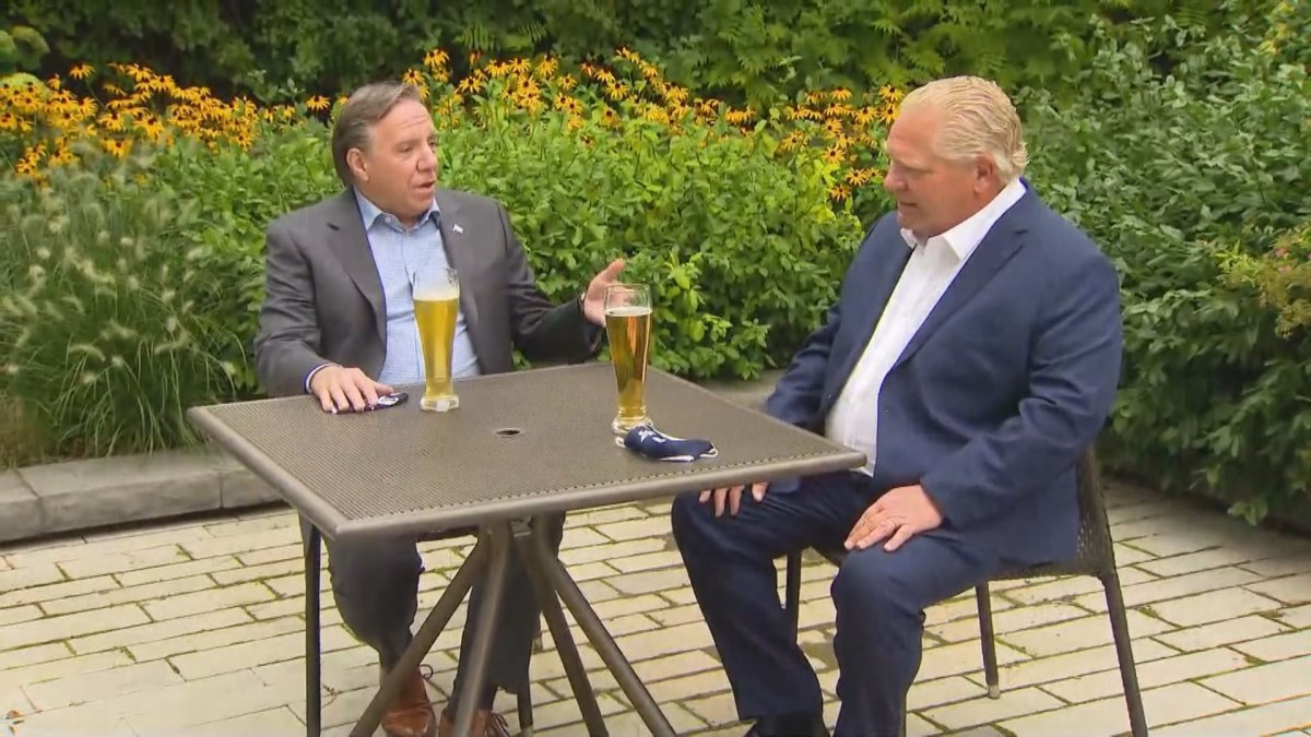 Ontario Premier Doug Ford (front) and Quebec Premier François Legualt sip beer in Toronto. Legault is in Ontario for a two-day summit hosted by Ford to discuss how the two provinces can work together to rebuild their economies. Tuesday, Sep. 8, 2020.