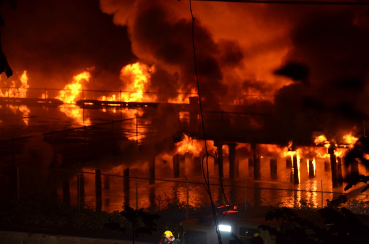 Flames are seen at the height of New Westminster's Pier Park fire on Sunday, Sept. 13, 2020.