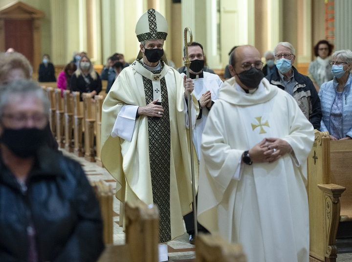 Archbishop Christian Lepine, left,  arrives to celebrate a mass to remember the unclaimed dead at Mary, Queen of the World Cathedral Wednesday, September 16, 2020  in Montreal.