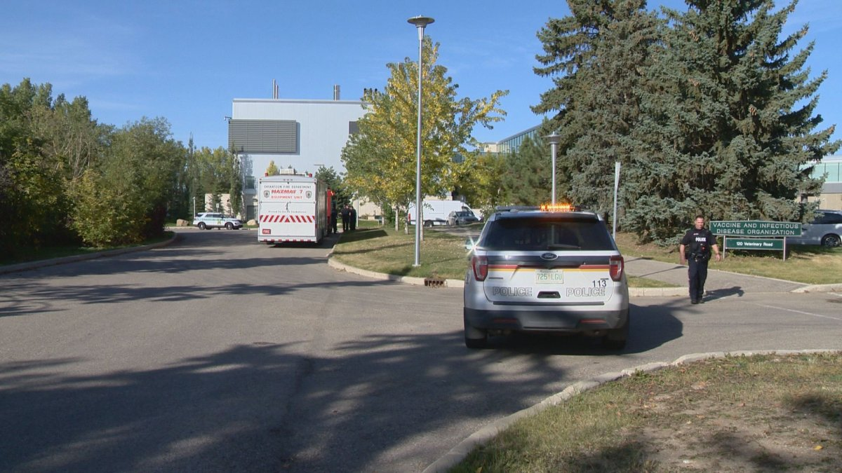 A Saskatoon Fire Department hazmat team and police car parked outside the VIDO-InterVac labs on Tuesday.