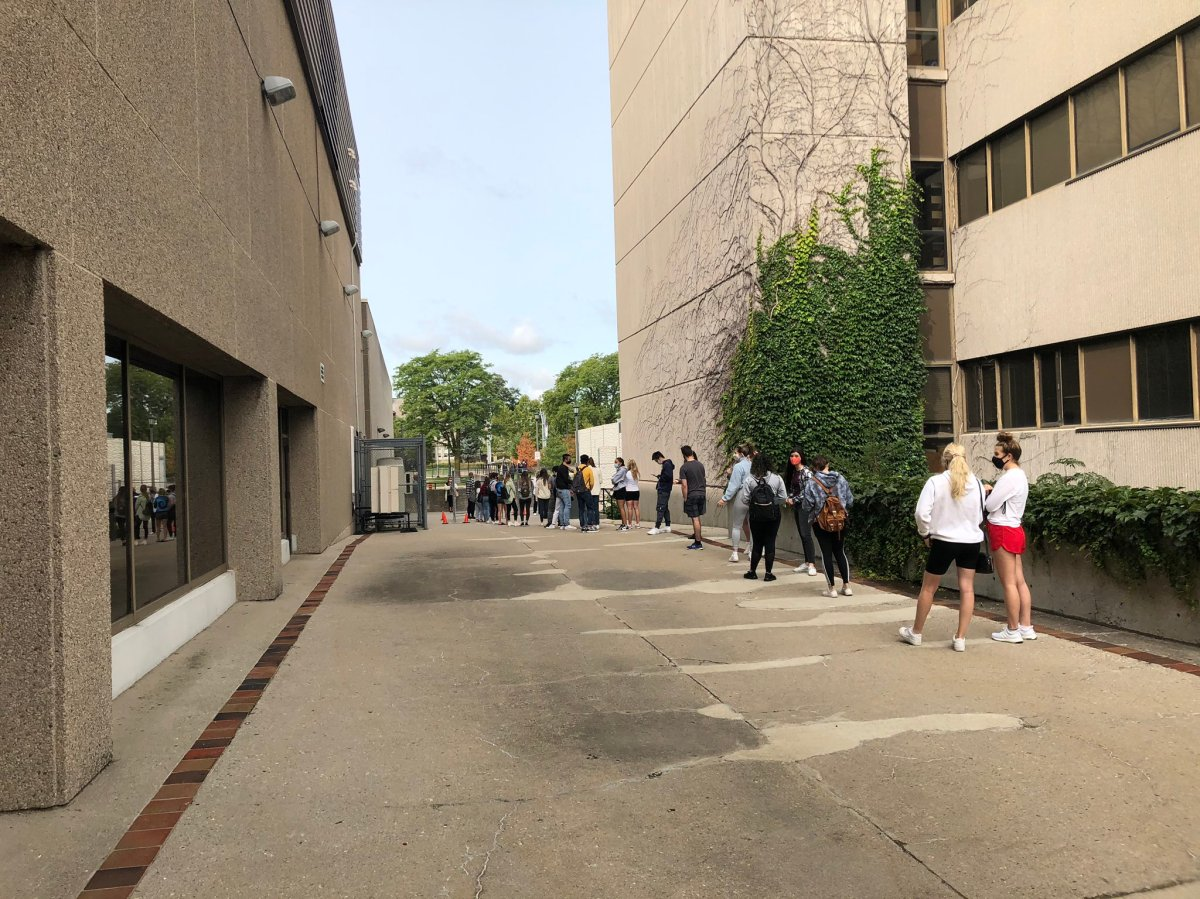 Western University students line up for an on-campus COVID-19 testing centre on Monday morning.
