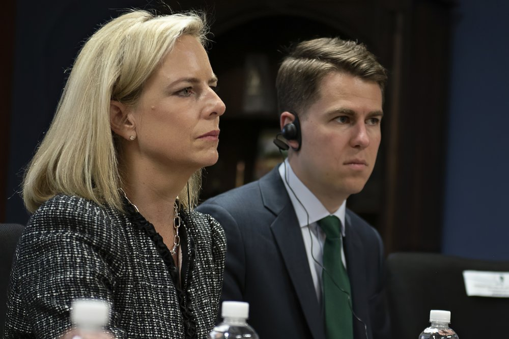 "This March 27, 2018, provided by the Department of Homeland Security, then-Secretary of Homeland Security Kirstjen Nielsen and then-Department of Homeland Security chief of staff Miles Taylor, right, meet with Honduran President Juan Hernandez, not pictured, and security ministers from the Northern Triangle countries in Tegucigalpa, Honduras. Taylor, a former Trump administration official who penned a scathing anti-Trump op-ed and book under the pen name ""Anonymous"" made his identify public Wednesday, Oct. 28, 2020."