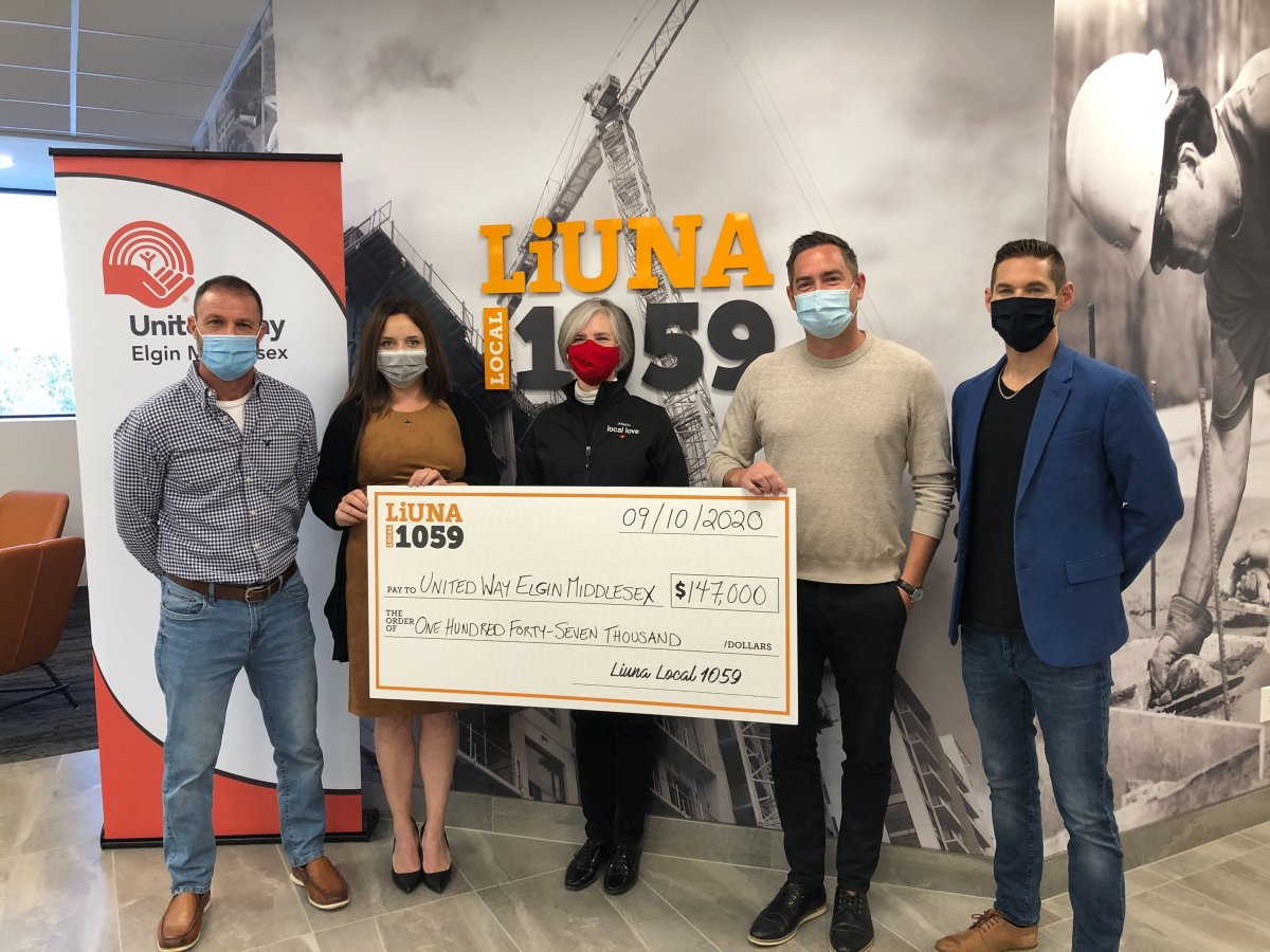 LiUNA Local 1059 business manager Brandon MacKinnon (second from right) is joined by fellow LiUNA members during a cheque presentation to United Way's director of development Jennepher Cahill (centre).